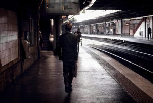 A young man is exiting the subway Cité Universitaire.