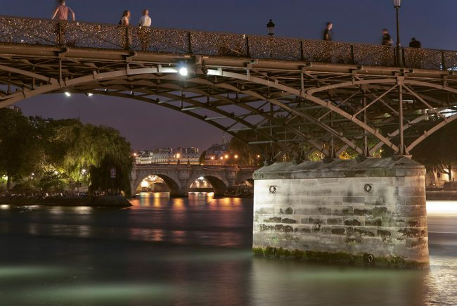 The padlocks of the famous Pont des Arts in the parisian night.