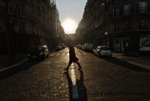 A bald Parisian crosses rue Bouchut outside the crosswalk.