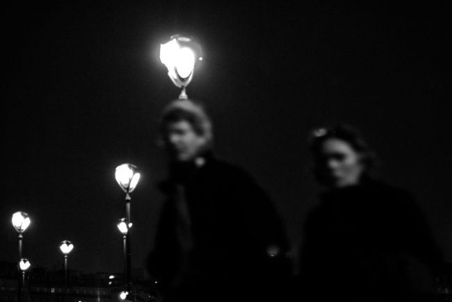 A couple disappears into the night in Paris.