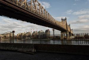In NYC, the Queensboro Bridge connects the island of Manhattan to the Queens borough.