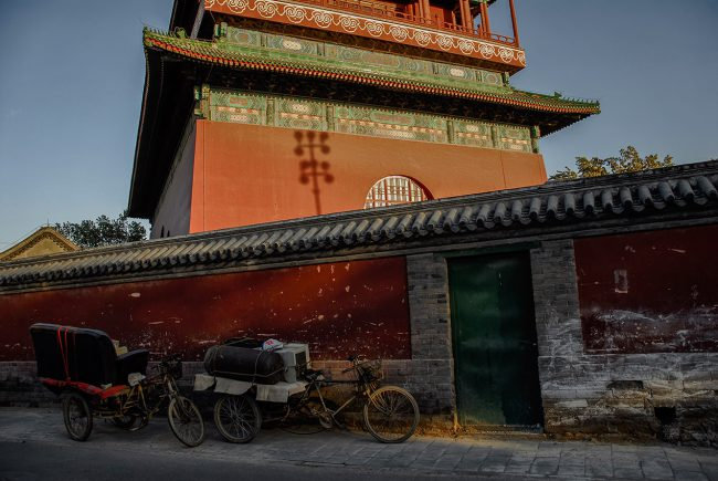 Bicycles are parked in front of the Clock Tower in Beijing.
