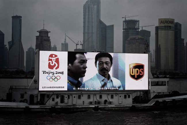 An advertising boat is crossing the Huangpu River in Shanghai.