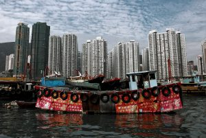 A fishing boat is moored in the harbor of Aberdeen in Hong Kong.