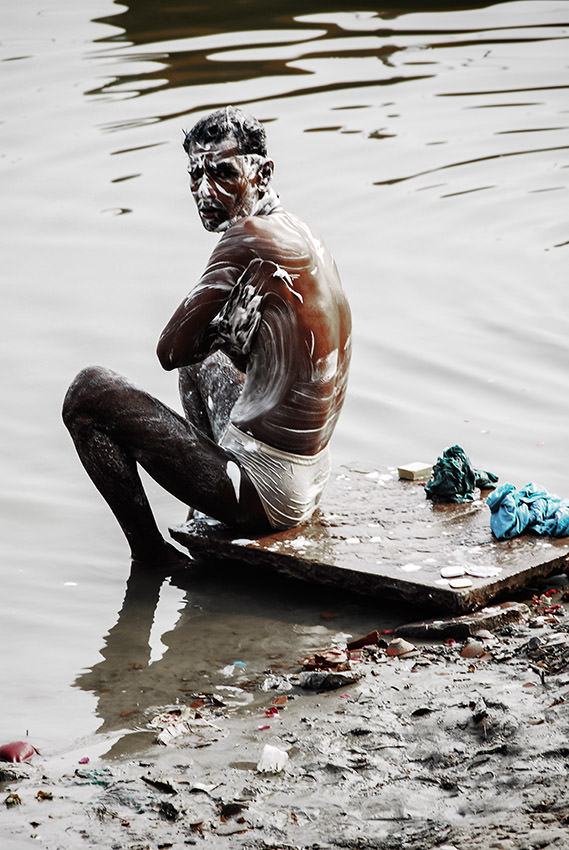 An Indian washes himself in the Ganges in Varanasi.