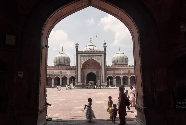 A little girl comes out of Jama Masjid mosque in Old Delhi.
