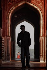 An Indian is walking in one of the two adjacent mosques at the Taj Mahal in Agra.
