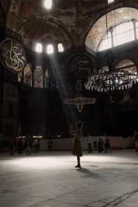 A young woman takes a picture inside the Hagia Sophia museum in Istanbul.