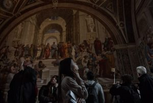 Tourists contemplate paintings inside the St. Peter's Basilica in the Vatican.