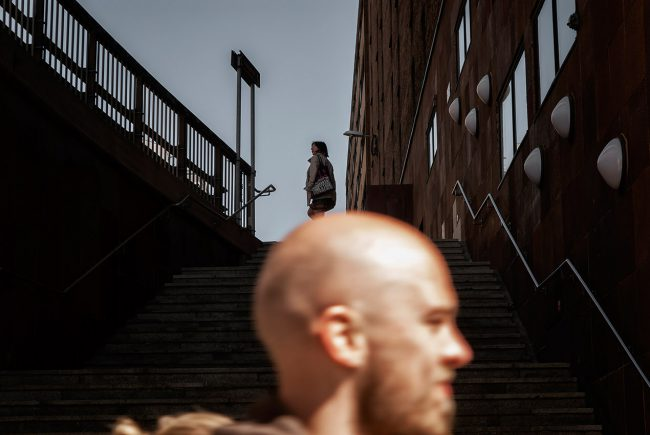 In Stockholm, a Swedish young man is walking down a street in the Norrmalm district.