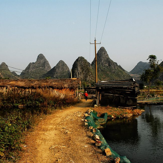 In south China, around Yangshuo, this is a countryside landscape around the karst mountains.