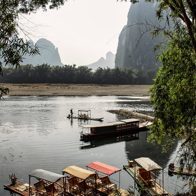 In south China, a boatman is approaching the shore near Yangshuo.