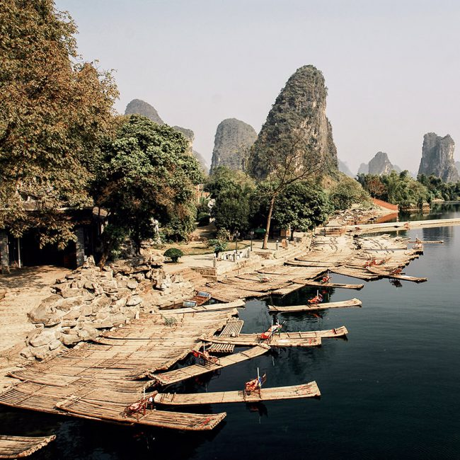 Makeshift bamboo boats are ready to welcome tourists on the Li River to Yangshuo in south China.