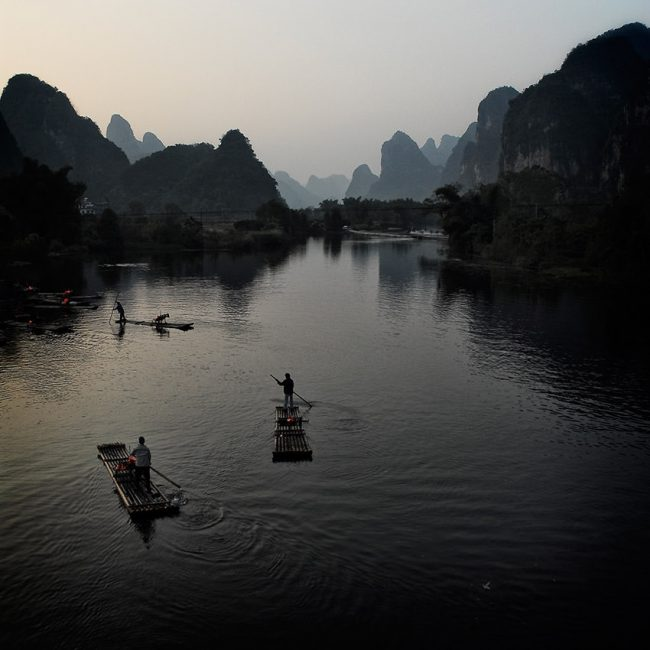 In the south China, boatmen return on the bank of the Li River to Yangshuo at night.