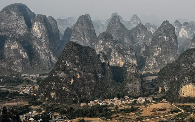From Moon Hill, an overlooking of the Yangshuo countryside and its singular mountains.