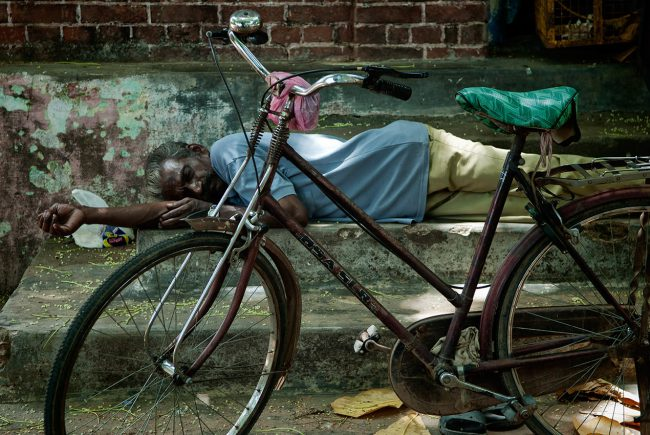 A man is taking a rest in Thanjavur, South India.
