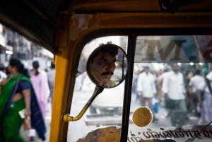 Portrait of a rickshaw driver in the bustling center of Trichy, South India