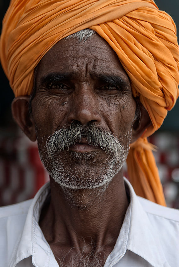 Portrait of a Rajasthani pilgrim inside the temple of Kanchipuram, South India