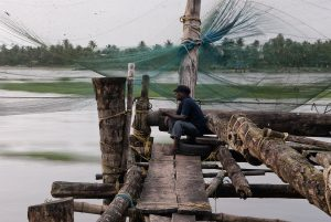 Angler in Kochi sitted on the seafront, South India