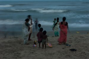 An indian family celebrates Ganesh festival, on the beach in Mahabalipuram, South India