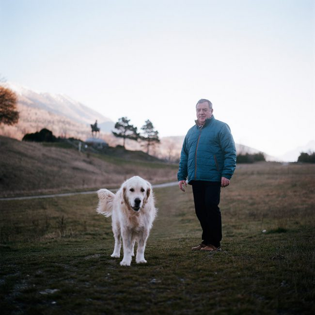 Portrait of Patrick and his dog on the meadow of the Encounter.