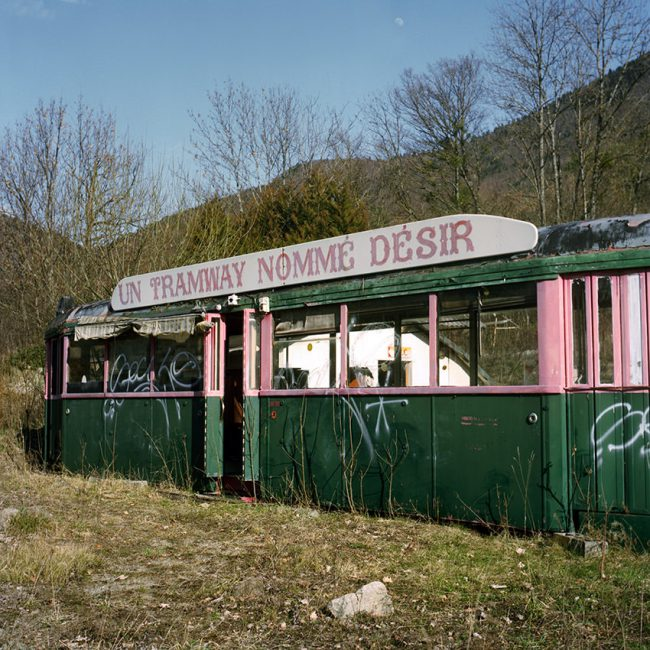 A former streetcar is abandoned on the Route Napoléon.