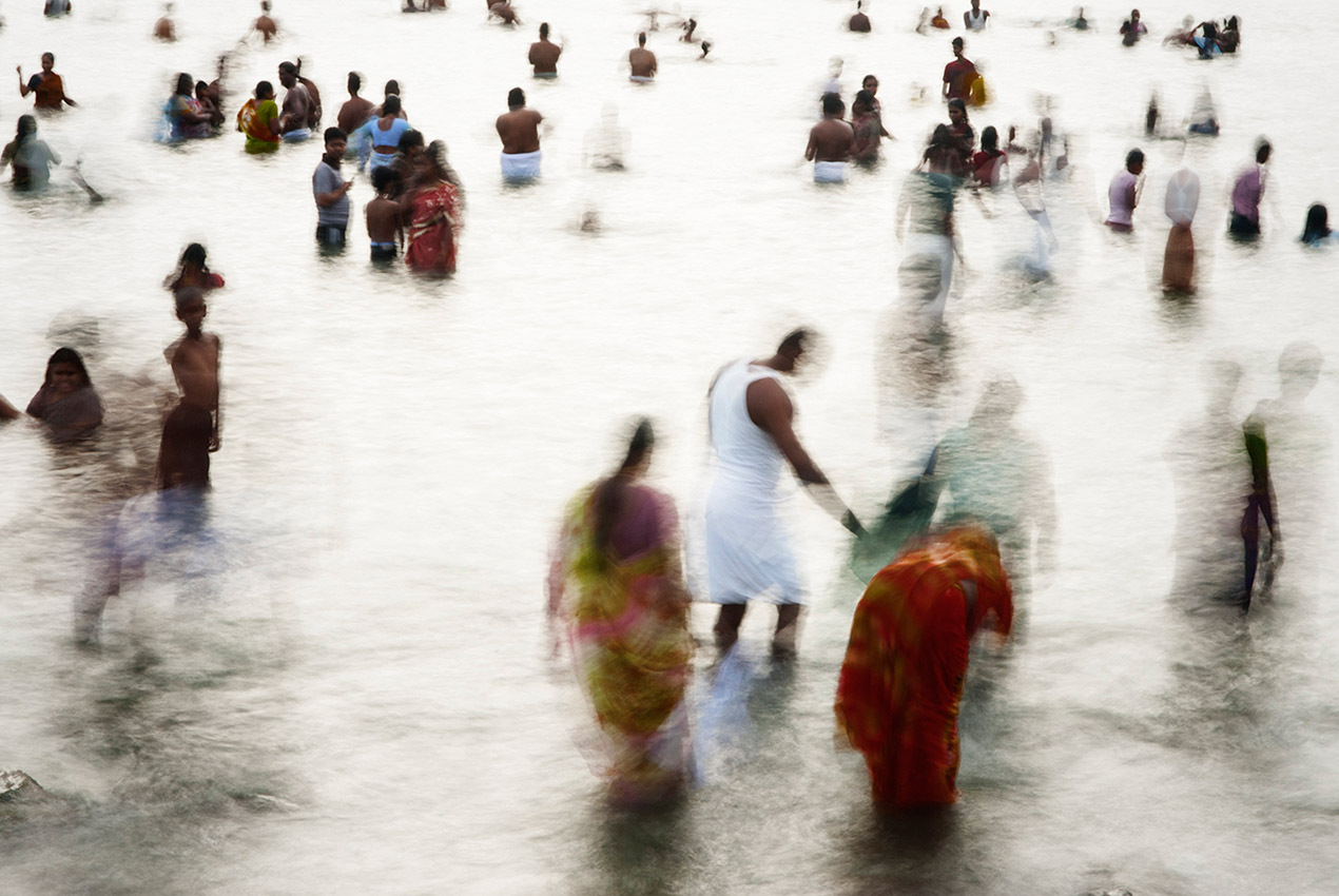 Facing the sun, Rameswaram ritual bath in the sea, 6am
