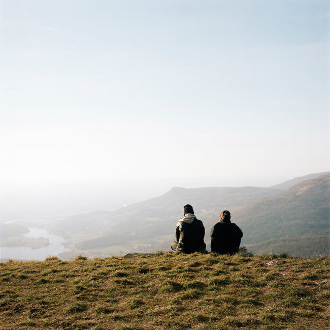 Two teenagers look at the landscape