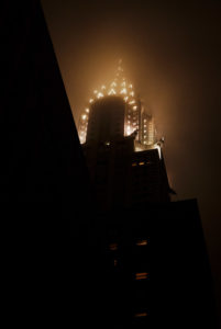 The Chrysler Building at night in the fog.