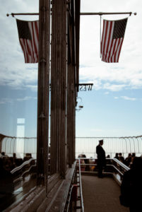 The American flag flies at the top of the Empire State Building