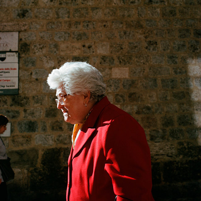 The old lady in the red coat