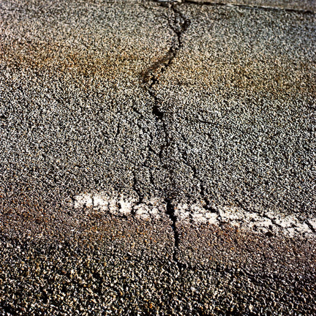 Asphalt cracks on Route Napoléon.